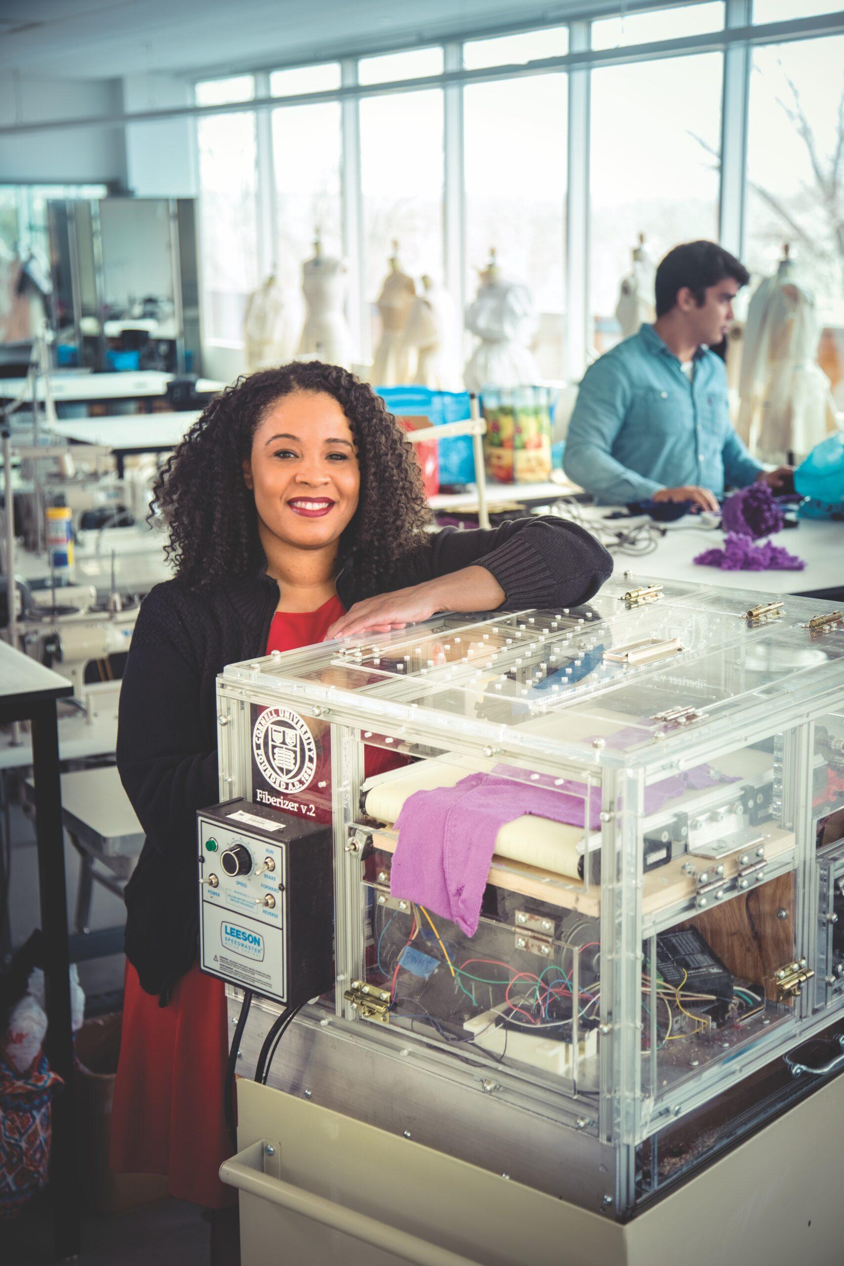 Professor Tasha Lewis with her Fiberizer machine