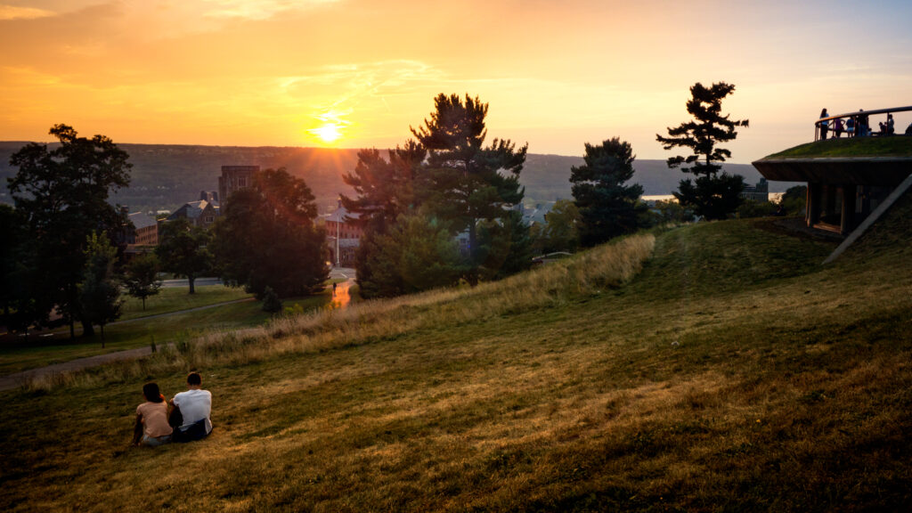 Students watch a sunset from a prime Libe Slope viewing spot
