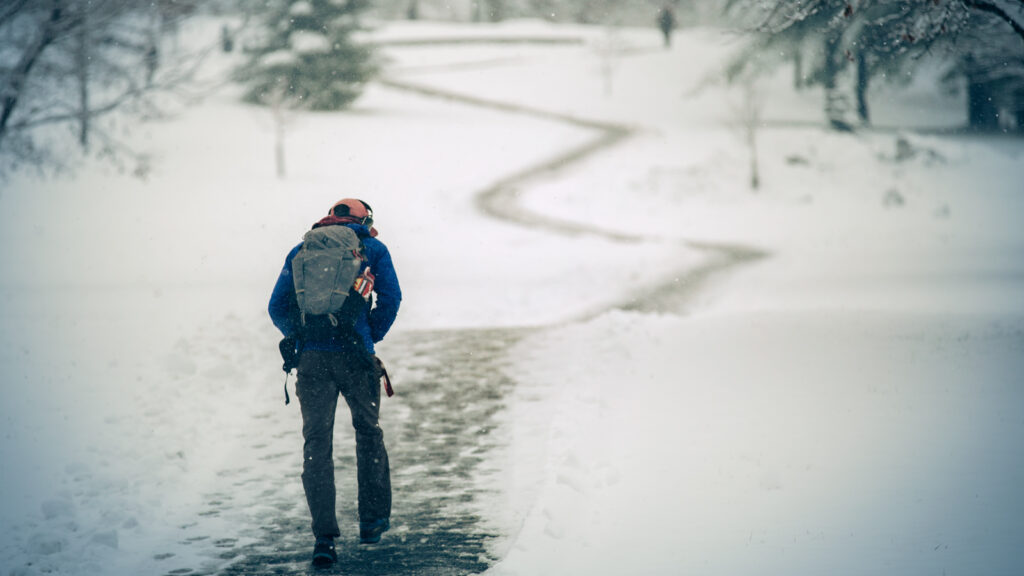 A student begins the long ascent up Libe Slope after a fresh snowfall