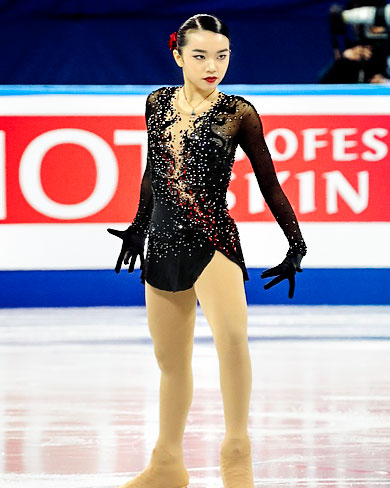 Karen Chen on the ice in a black sequined figure skating costume.