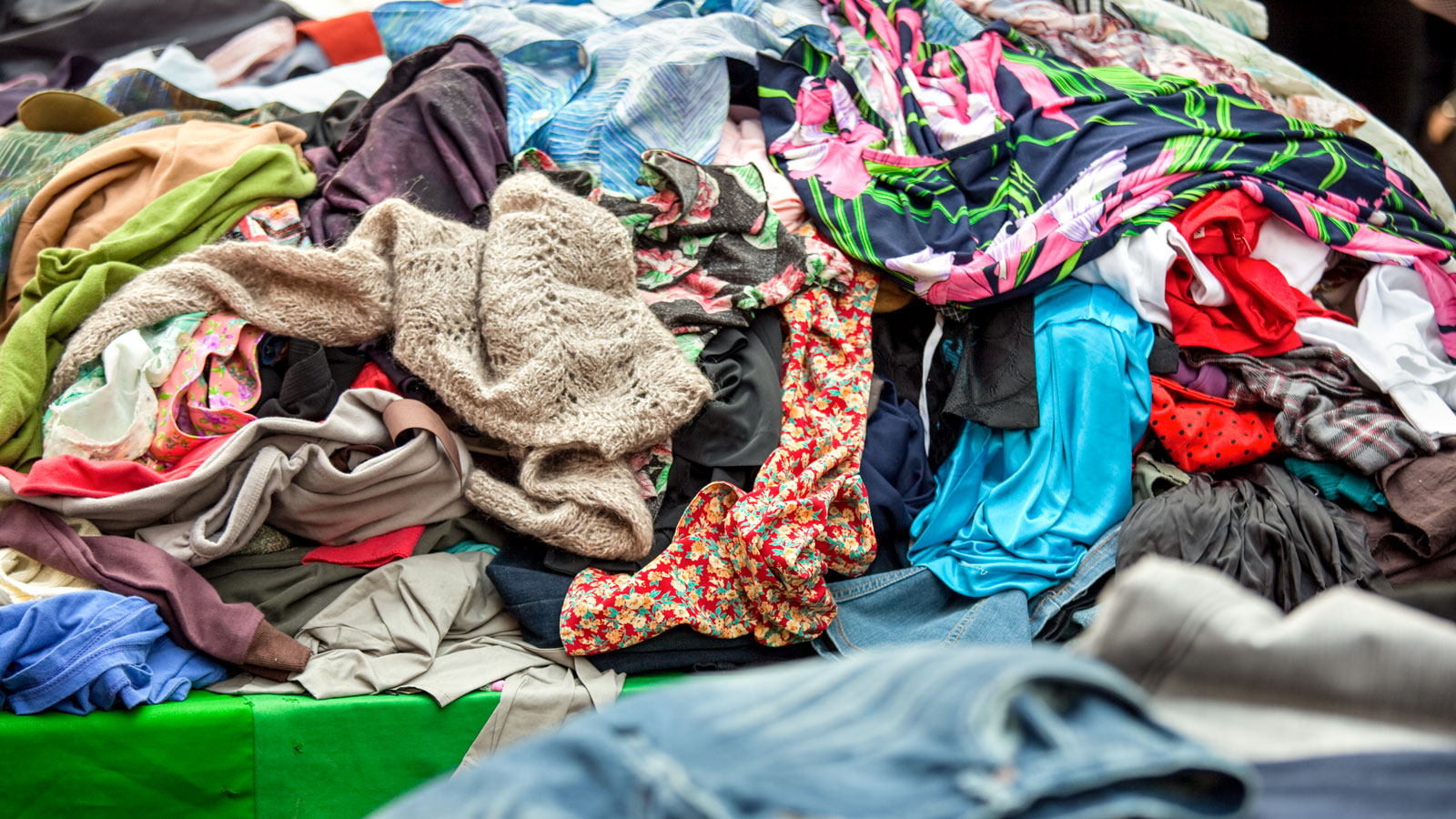 A pile of used clothing at a flea market.