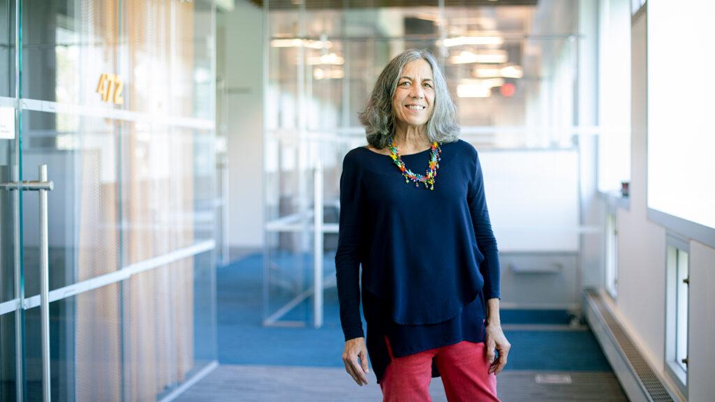 Prof. Jodi Cohen standing in a hallway