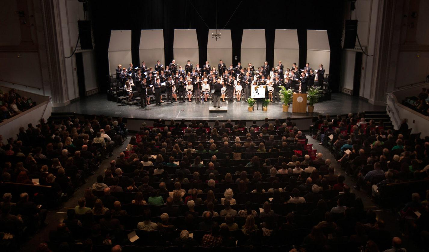 "The Cornell Glee Club performs ""Amazing Grace"" at the memorial gathering for President Elizabeth Garrett, a highlight for many in attendance in Bailey Hall and watching via livestream."