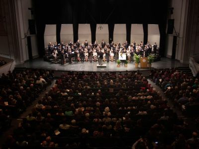 """The Cornell Glee Club performs """"Amazing Grace"""" at the memorial gathering for President Elizabeth Garrett, a highlight for many in attendance in Bailey Hall and watching via livestream."""