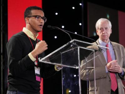 Rhodes scholar Ahmed Ahmed '17 offers inspiring, impromptu remarks after Interim President Hunter R. Rawlings III, in the background, gave him a shout-out, not knowing he was in the audience.