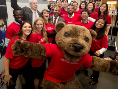 Robert Smith with President Hunter Rawlings, the Big Red Bear, and students at the 2016 Dedication of the Smith School of Chemical and Biomolecular Engineering (CBE).