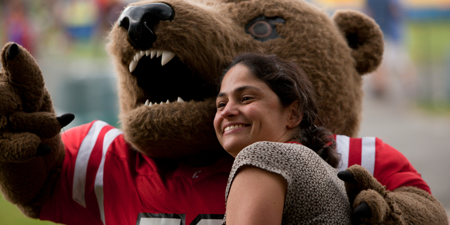 The Big Red Bear greets children and families during Reunion Weekend 2012.