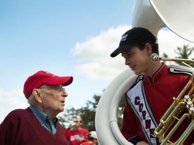 2016 Homecoming Weekend: An alumnus chats with a member of the Big Red Band at the Big Red Festival.