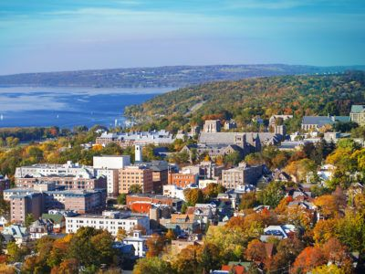 An aerial view in fall of central campus with Cayuga Lake in the background.