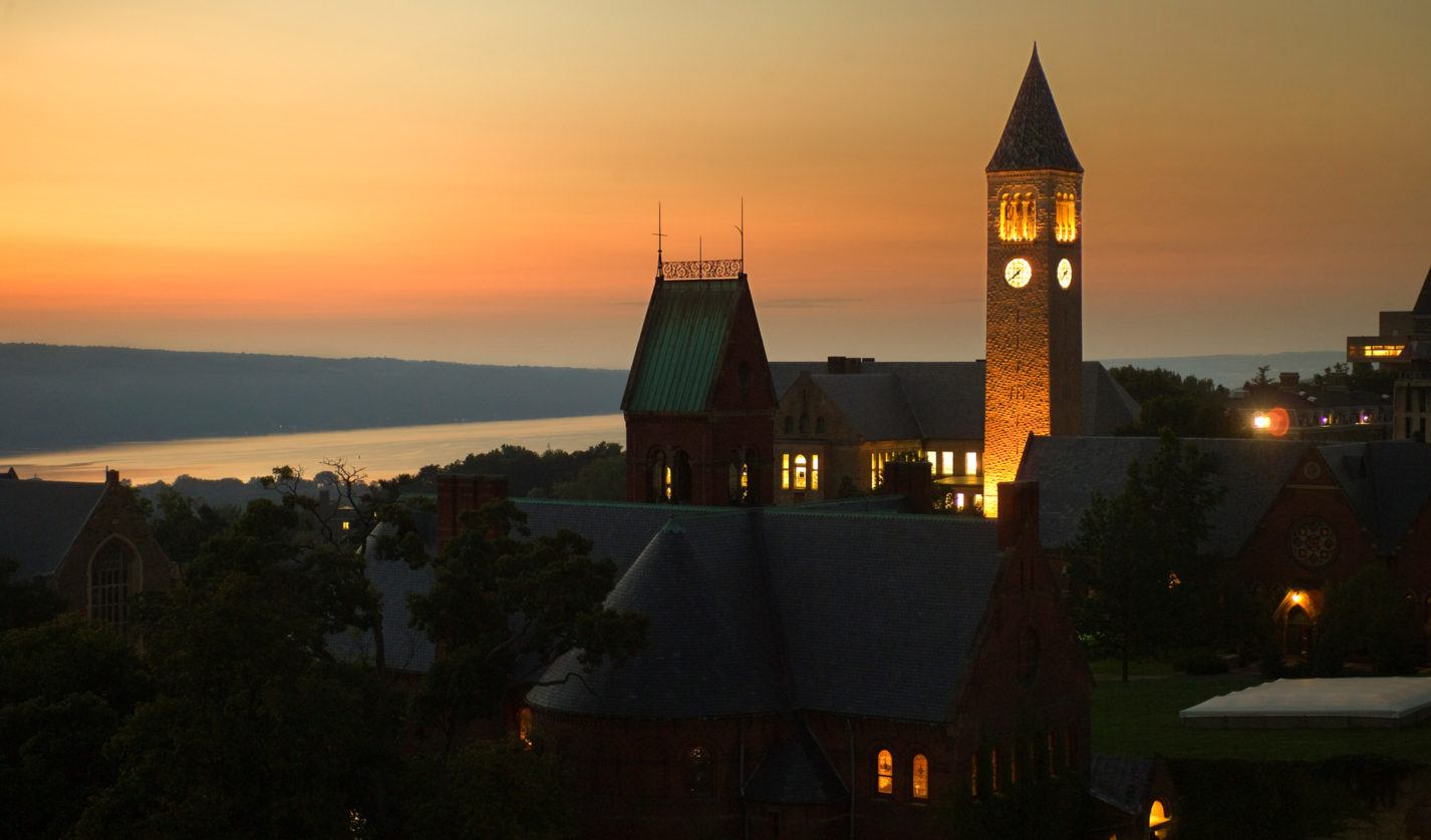 Central campus at dusk, with views of McGraw tower and Cayuga Lake.