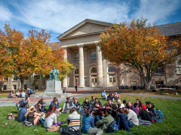 Students on the Arts Quad in fall, near Goldwin Smith Hall.