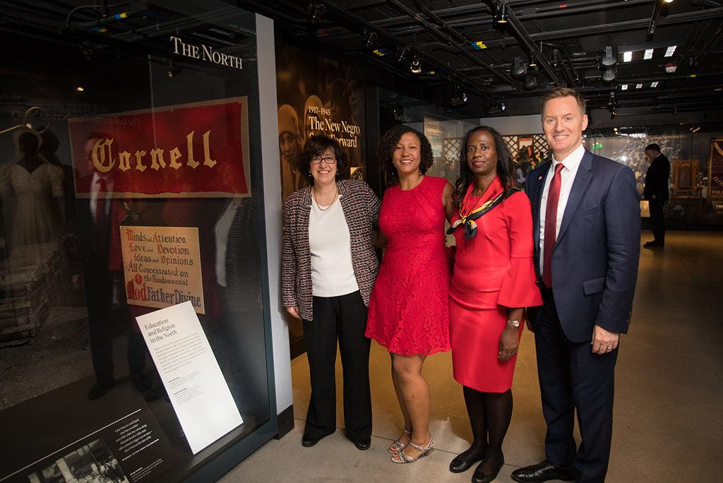 The Cornell president and alumni leaders pay tribute to the Cornell banner.