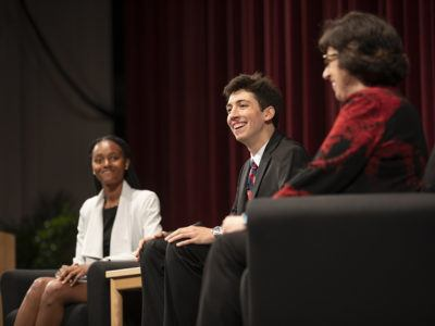 Troy Anderson '19, center, smiles as he answers a question from President Martha E. Pollack, right, during a Reunion Weekend presentation June 9 in Bailey Hall. At left is Maiquela Richards '18.
