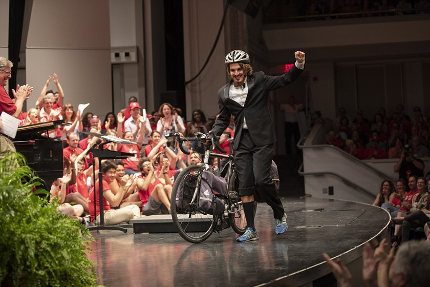 George Epstein '15—with his bicycle—takes the Baily Hall stage on Cornelliana Night.