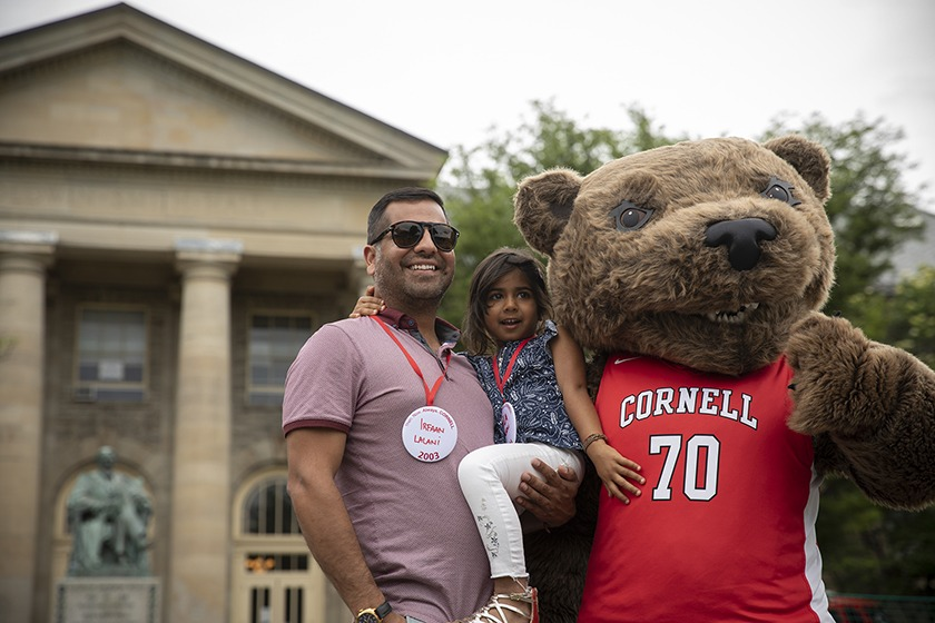 Irfaan Lalani '03 and his daughter meet Touchdown the Bear.