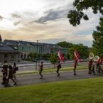 Alumni of the Big Red Bands march toward the Arts Quad.