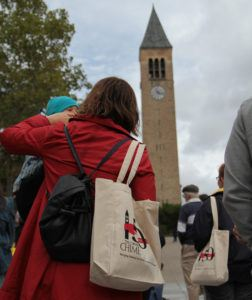 Spectators celebrate the sesquicentennial of the Cornell Chimes, listening to a concert from Ho Plaza.