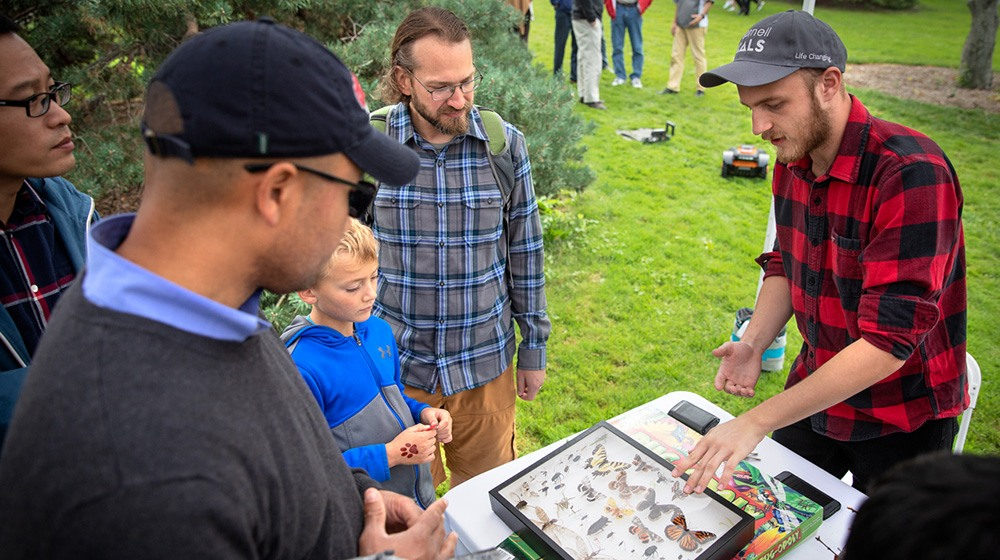 Jacob Gorneau '20, a member of Snodgrass and Wigglesworth, Cornell's undergraduate entomology club, tells visitors about butterflies.