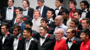 Alumni of the Cornell University Glee Club join the current members of the ensemble to sing the alma mater.