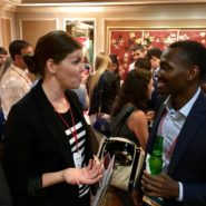 Photo of alumni talking at a social event
