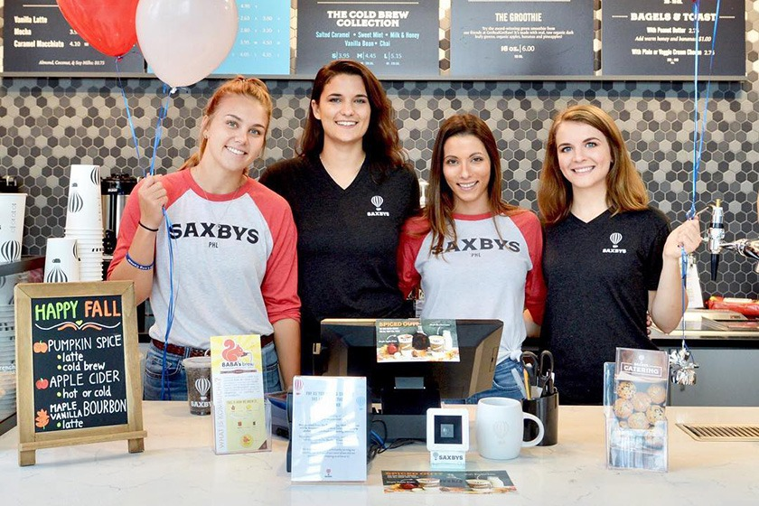La Salle University students behind the counter at a Saxbys Pay-As-You-Wish fundraising event.