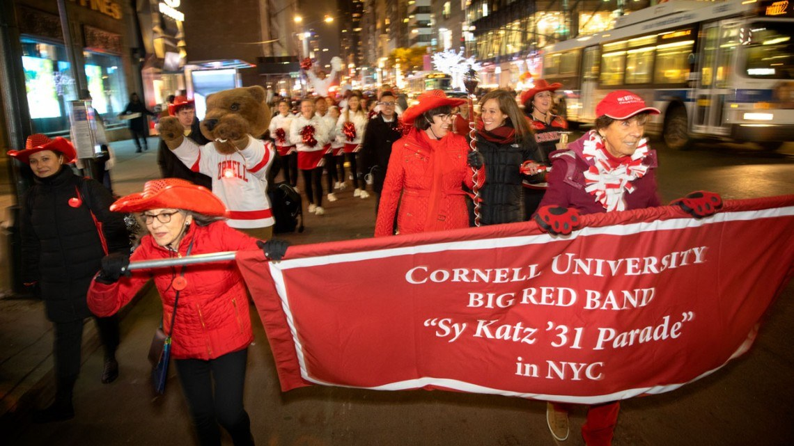President Martha E. Pollack and her daughter, Anna Gottschlich, lead the 2018 Sy Katz '31 Parade.