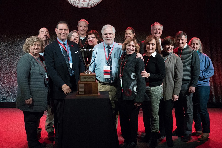A group of alumni after winning the Cornell Alumni Association Cup