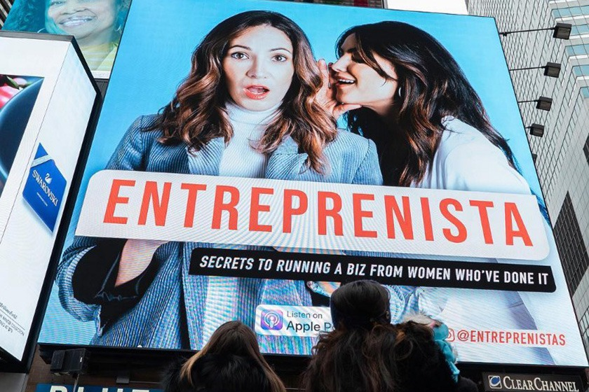 Stephanie Cartin '06 and Courtney Spritzer on a billboard for their Entreprenista podcast.