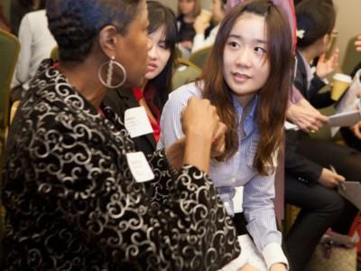 Alumna speaking with undergraduate student