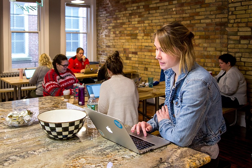 GiveGab employee Jaclyn Saksa works on her laptop in the GiveGab headquarters