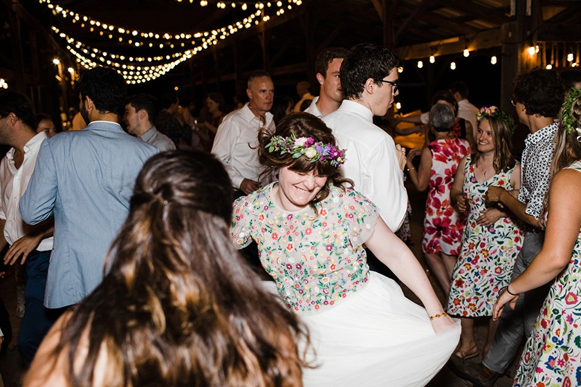 Wedding guests dance at an Ithaca Farmers Market reception