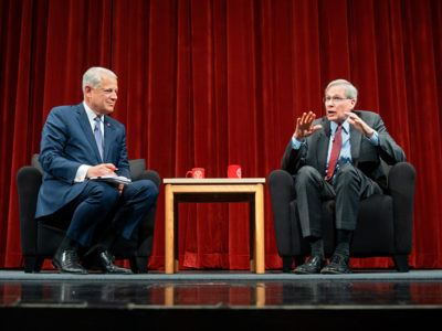 Former national security adviser Stephen J. Hadley '69 talking on stage with former Rep. Steve Israel, left, director of Cornell's Institute of Politics and Global Affairs.