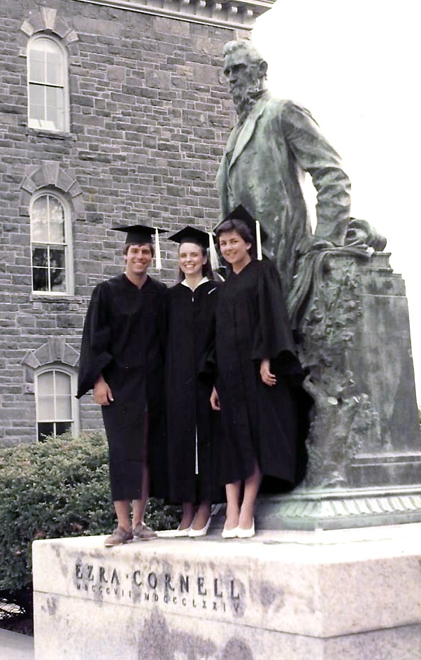 Graduation 1984: (left to right) Ted Clark, Christine Miller Whaley, and Terri Port beside the statue of Ezra Cornell.