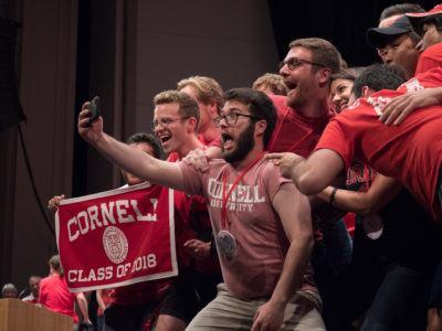 Glee Club and Chorus members taking a selfie at Cornelliana Night during Reunion 2018