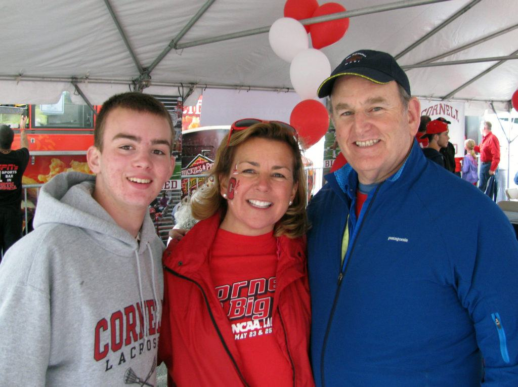 Terri Port with her family at the 2013 NCAA Lacrosse Championships in Philadelphia, where Cornell went up against Duke in the semifinal match: (left to right) Terri's son Harry Port McClellan, Terri Port, and Terri's husband, Steve Lishansky.