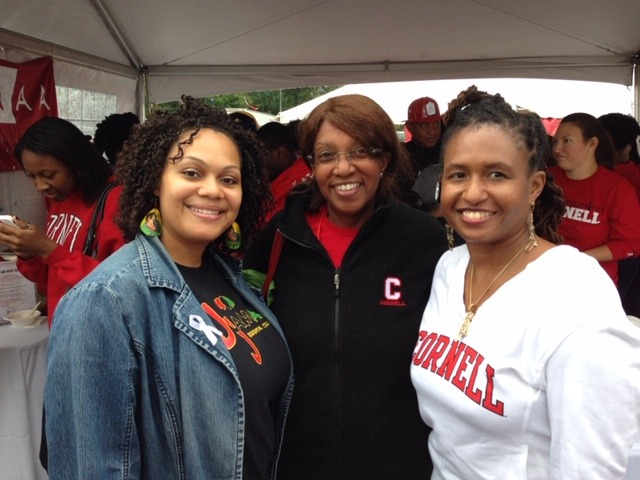 Cynthia Cuffie with two friends, wearing Cornell gear