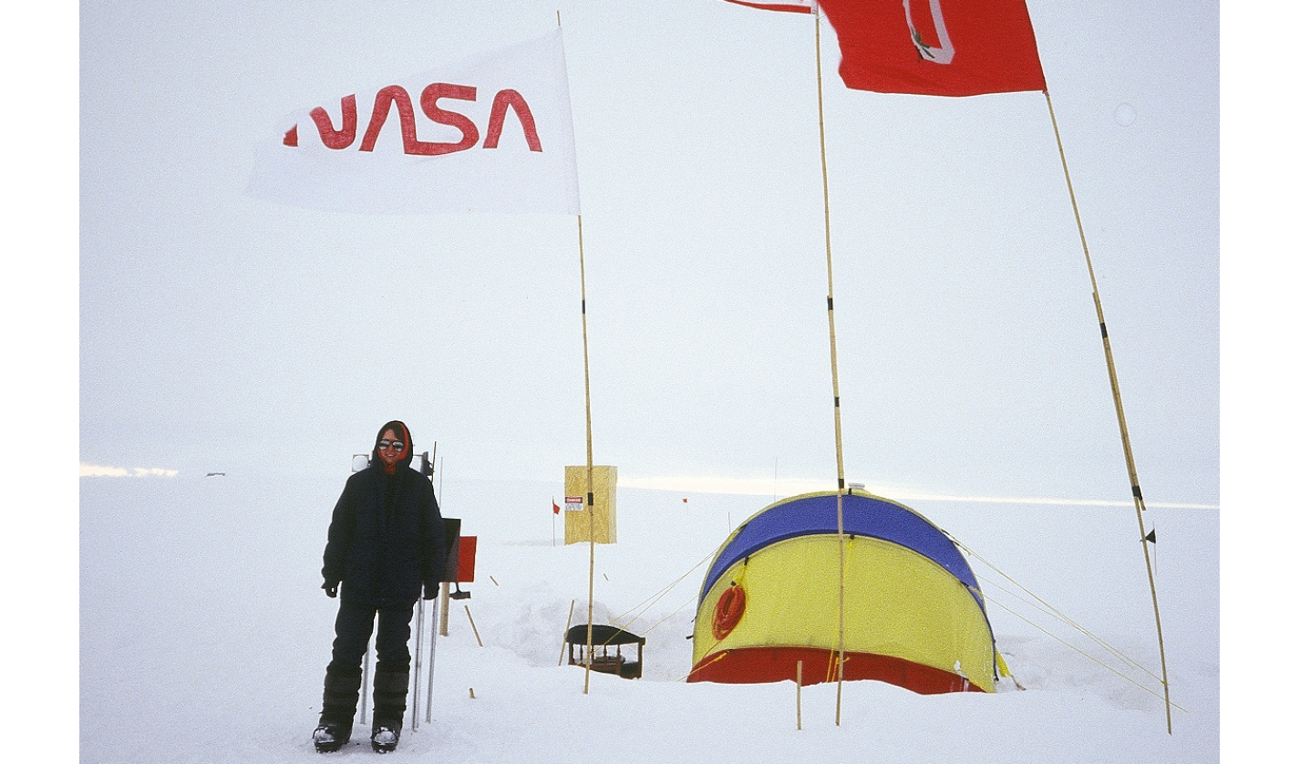 Ingrid Zabel '87 on the Greenland ice sheet during the summer of 1993. Zabel was one of eight researchers who worked at this site. This communal tent is where the team cooked, ate, and worked.