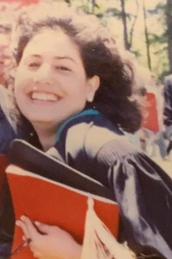 Lorette Simon Gross in a graduation robe