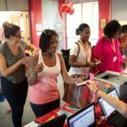 Volunteers help register Reunion attendees.