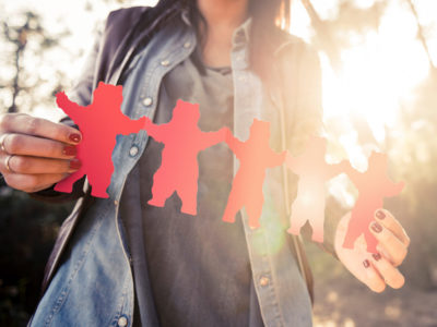 Woman holding red bear cut outs