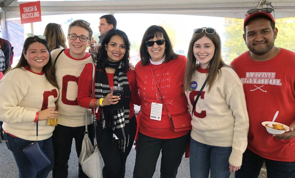 Young alumni join President Martha Pollack in celebrating generations of Big Red pride at Homecoming.