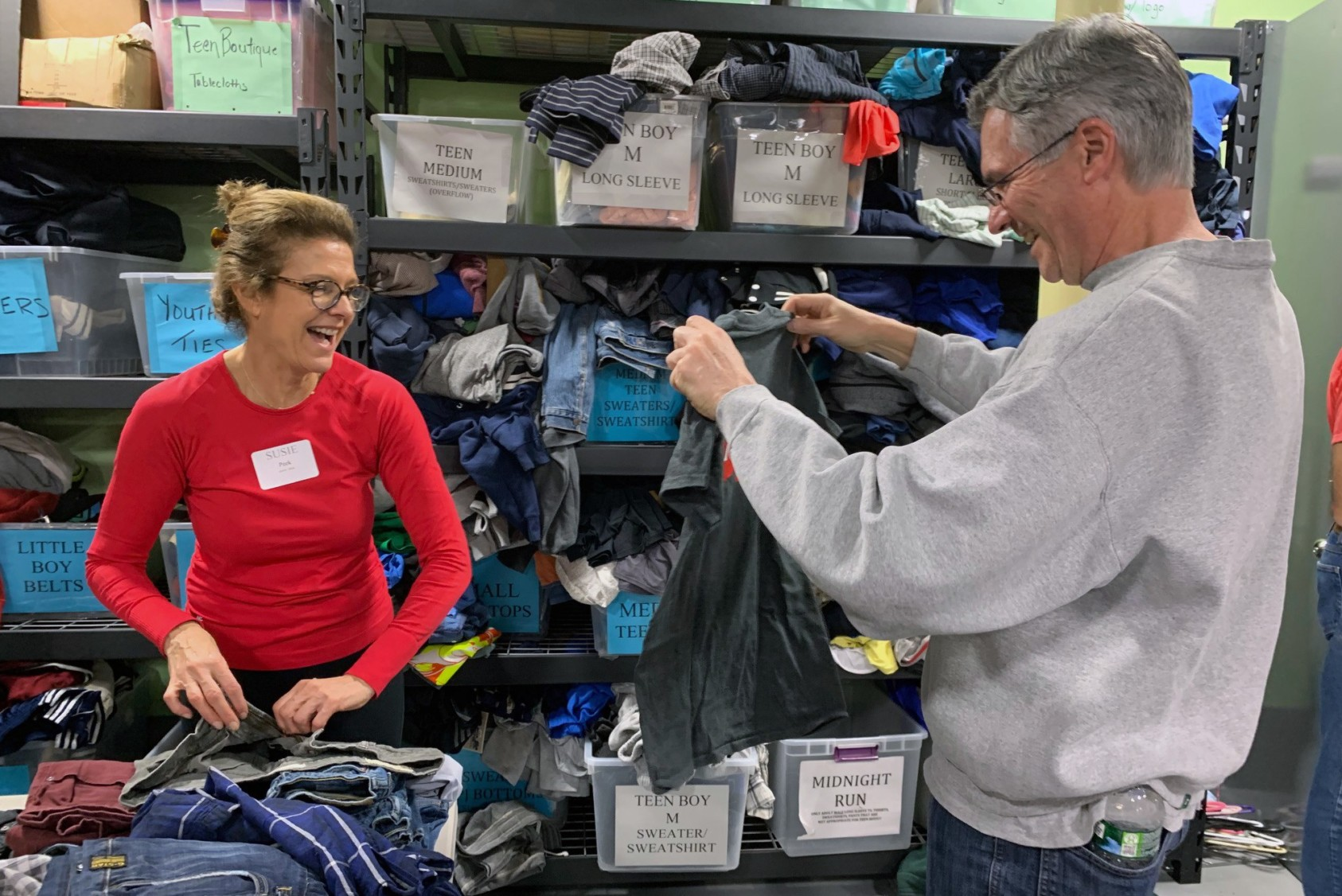 Cornell Alumni Association of Westchester volunteers sort donations of new and gently used clothing, shoes, and coats.
