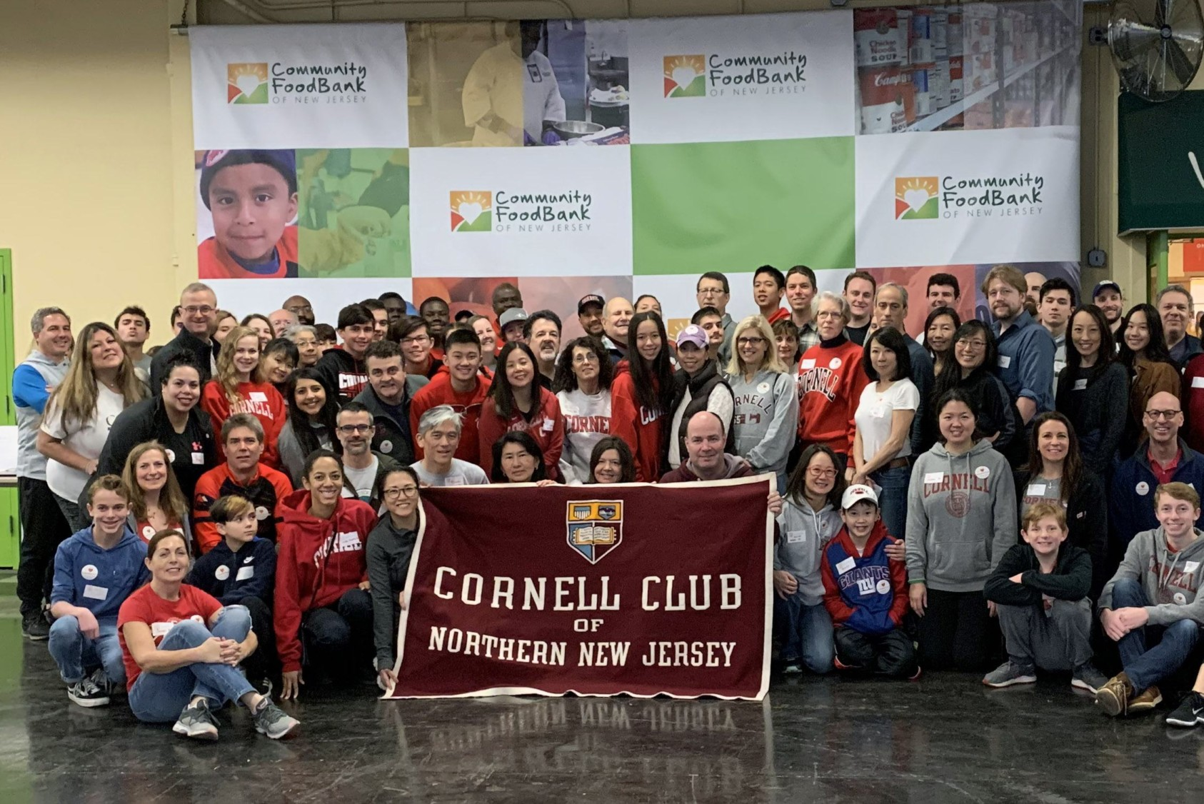 The afternoon shift of volunteers from the Cornell Club of Northern New Jersey at the Community Food Bank of New Jersey in Hillside.