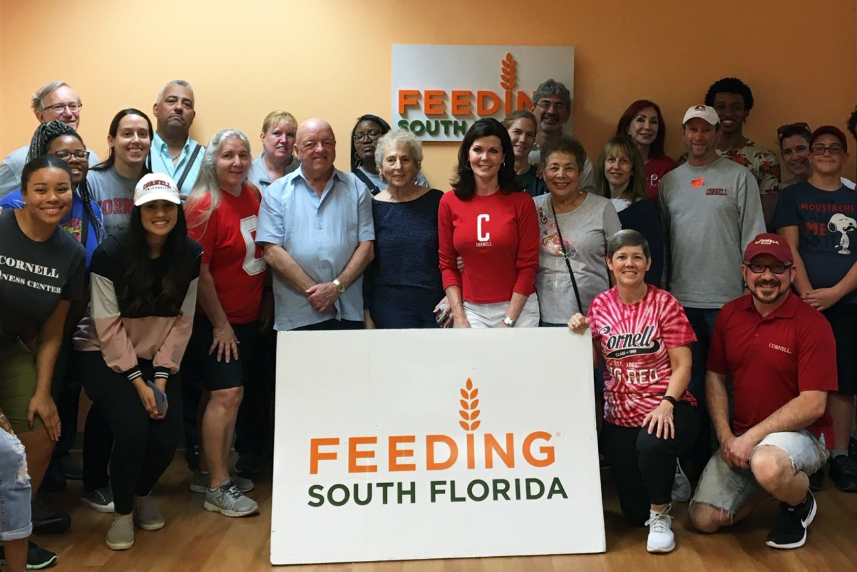 Volunteers from three South Florida Cornell clubs spent their day inspecting, sorting, and packing food for Feeding South Florida, which provides food to more than 700,000 neighbors. Matt Carcella (kneeling with a red Cornell cap) director of Diversity Alumni Programs and US Regional Alumni Engagement, joined in.