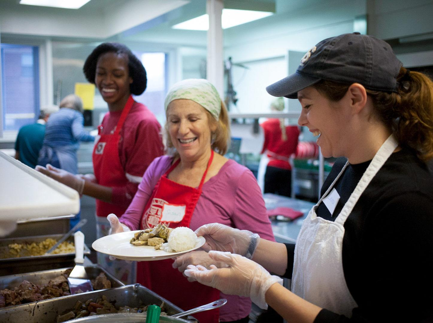 Students and staff volunteer at Loaves and Fishes as part of the Public Service Center (PSC) Into The Streets event.