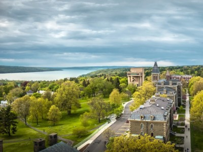 Central campus in spring, with Cayuga Lake, the Arts Quad, Libe Slope, Goldwin Smith Hall.