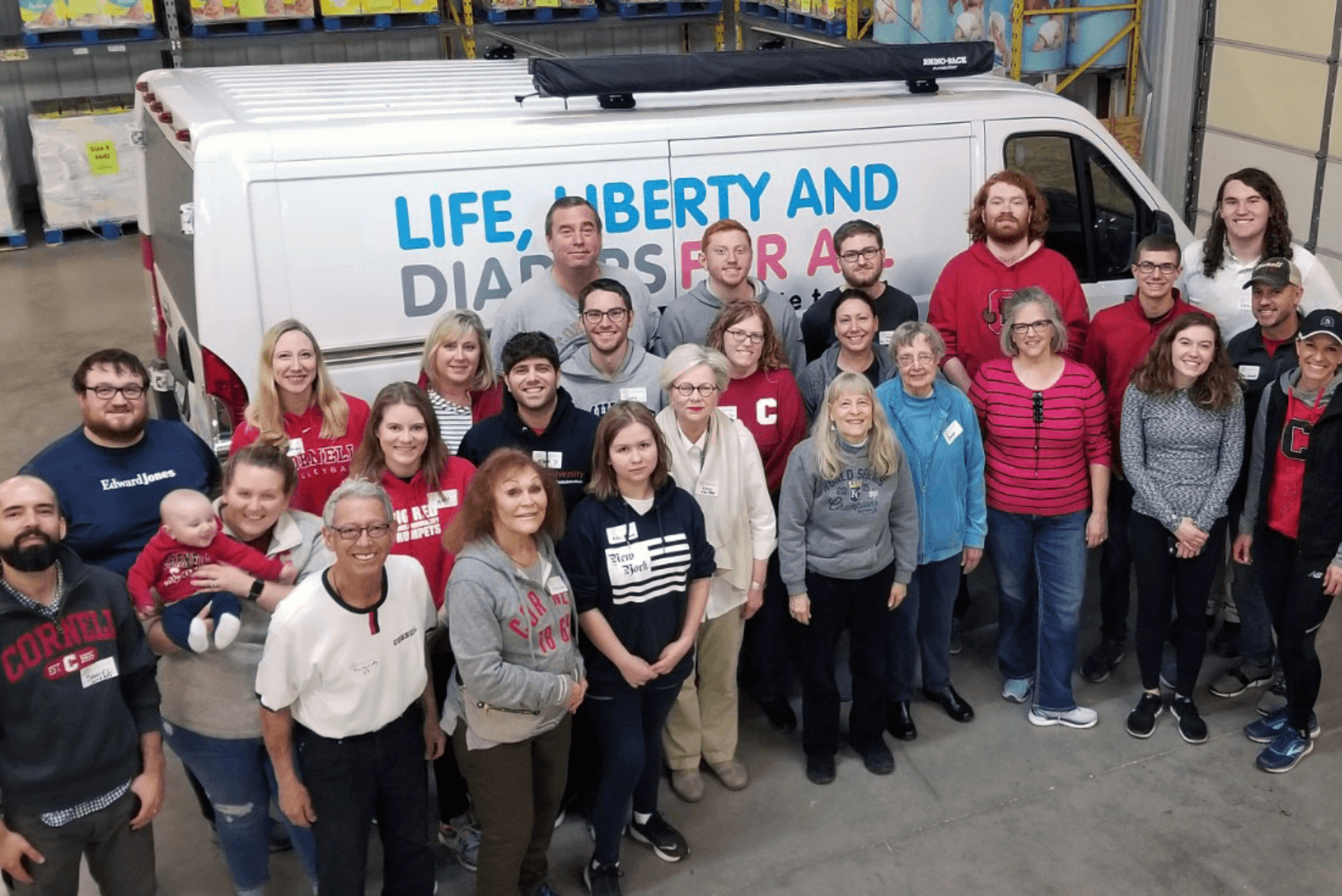 Cornell Club of Mid-America volunteers package diapers for hospitals and neighbors in need.