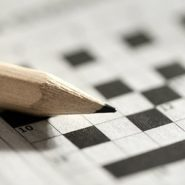 pencil and a blank crossword puzzle