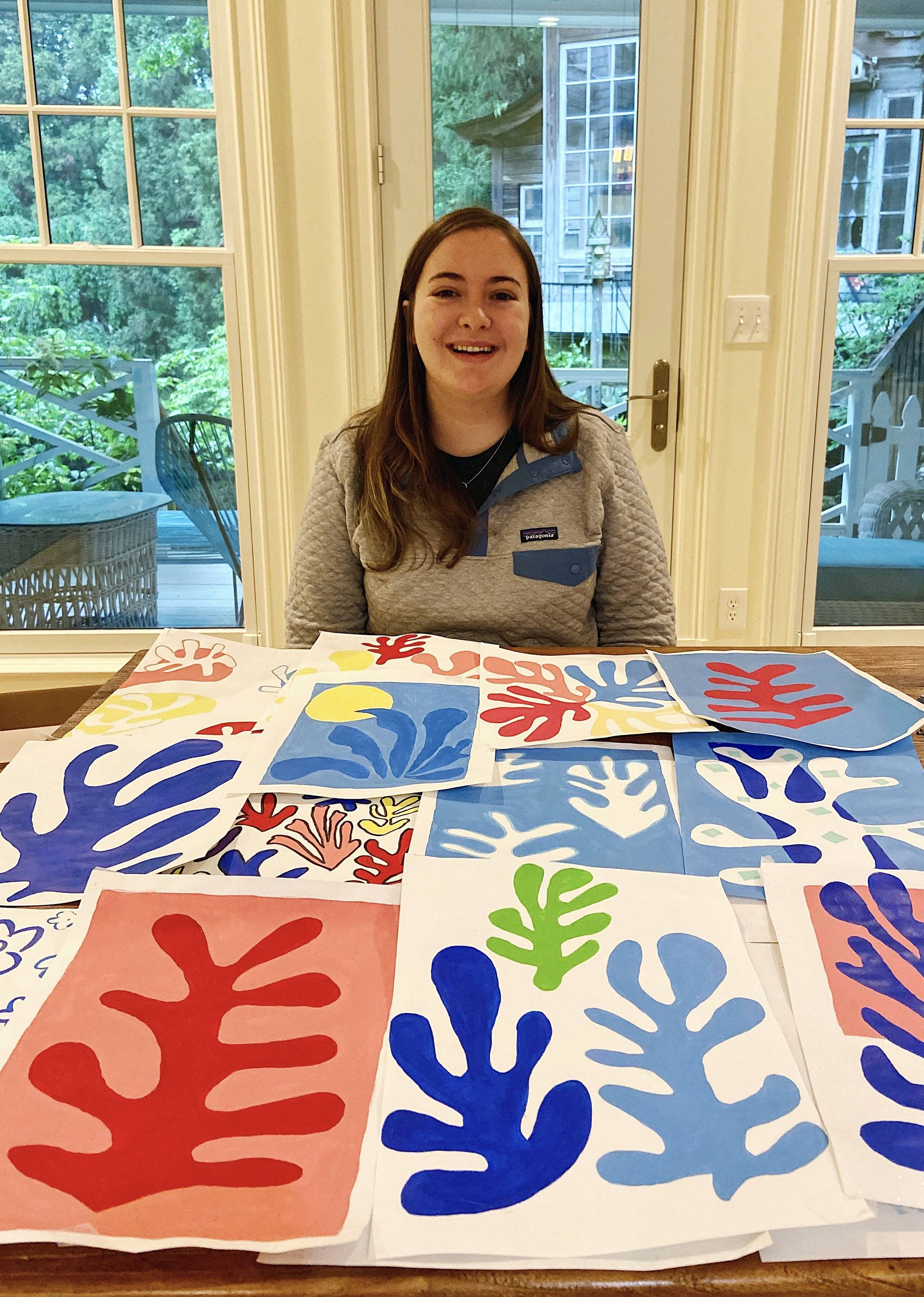 Colesy with some of the paintings she's made during the last few weeks.