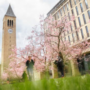 Campus in spring, students walking, McGraw Tower